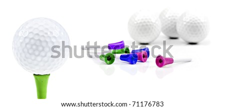 New golf balls and pins on a white background with space for text - stock photo