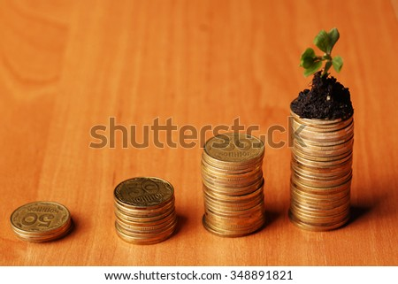 new green plant shoot growing from money - stock photo