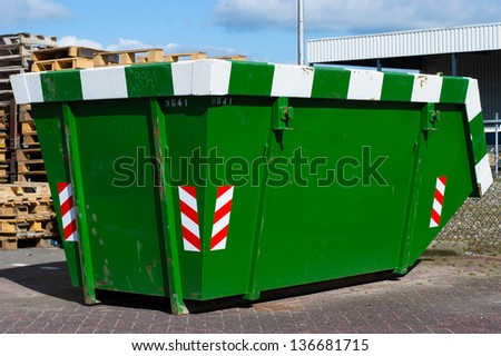 new green skip for waste disposal - stock photo