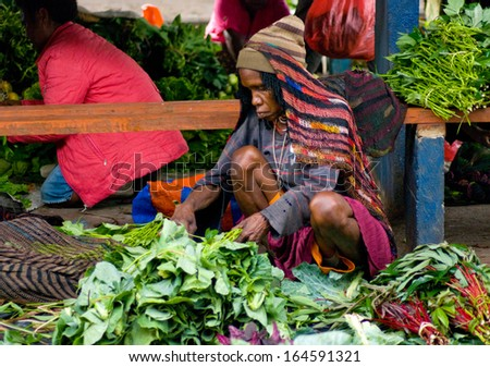NEW GUINEA, INDONESIA-DEC 28: Green vegetable displayed for sale at a local market in Wamena,on New Guinea Island, Indonesia on December 28, 2010. - stock photo