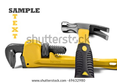 New hammer and wrench on a pure white background with space for text - stock photo