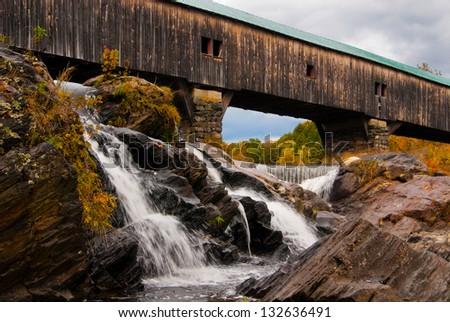 New Hampshire's Bath covered bridge in autumn. - stock photo