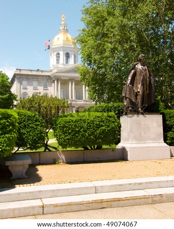 New Hampshire State capital building and Franklin Pierce statue - stock photo