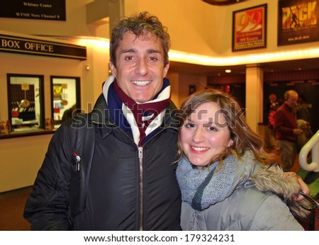 NEW HAVEN, CONNECTICUT- JANUARY 25, 2014:  Director Marc Vietor and Broadway actress Felicia Ricci (Wicked) arrive at The Shubert Theater to perform in the Yale Alumni musical, My Fair Lady - stock photo
