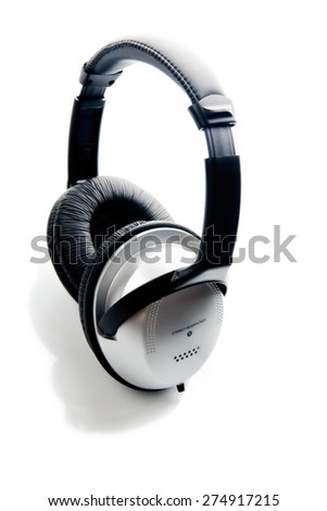 New headphones with leather head band over white background.