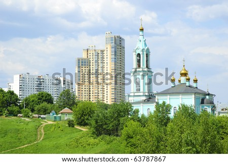New high-rise buildings and Orthodox Church - stock photo