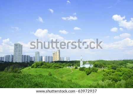 New high-rise buildings and Orthodox Church (Moscow Russia) - stock photo