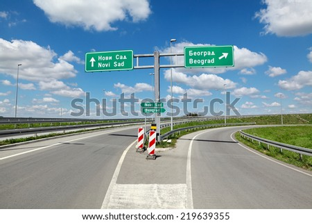 New highway crossroad in Vojvodina, Serbia known as corridor 10 with sign for Belgrade and Novi Sad - stock photo