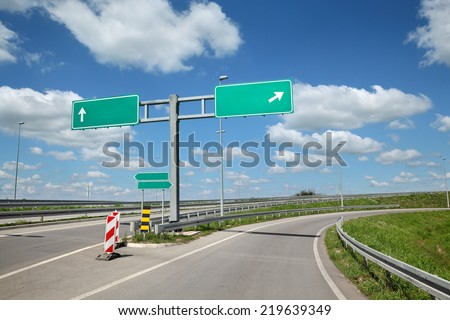 New highway crossroad with empty sign - stock photo