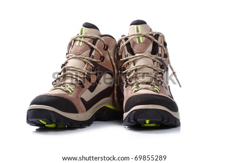 new hiking boots on white background - stock photo