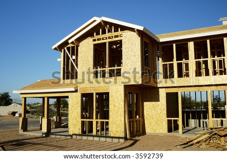 New home being built in a residential area. - stock photo