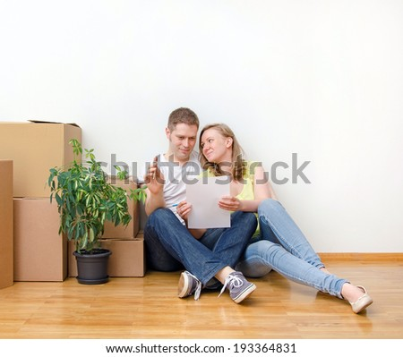 New home concept. Happy family sitting near boxes. - stock photo