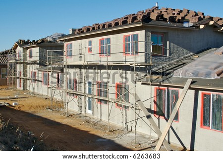 New Home Construction Site with freshly plastered walls and tiles ready for installation. - stock photo