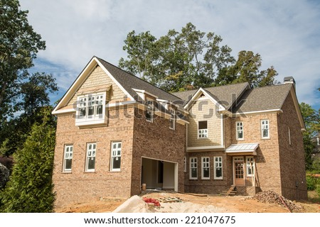 New home construction with new windows - stock photo