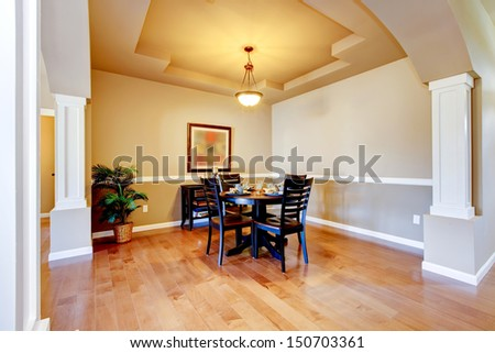 New home dining room interior with hardwood floors and table.