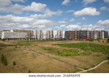 New home district with empty space for future construction - stock photo