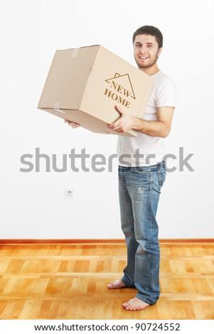 New Home -Man holding box - stock photo