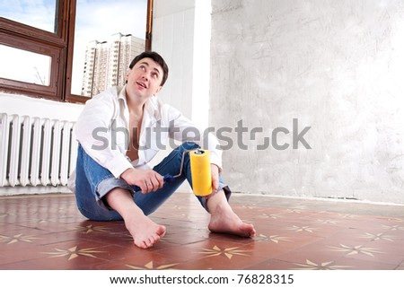 New home. Man in the new house. - stock photo