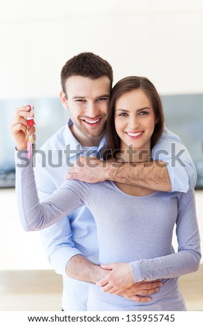 New home owners with key - stock photo