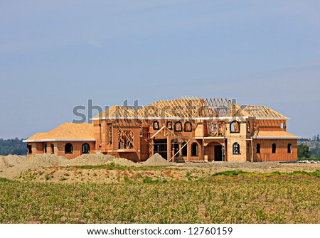 New home under construction. - stock photo
