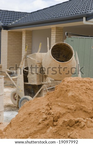 New home under construction, building tools in foreground - stock photo