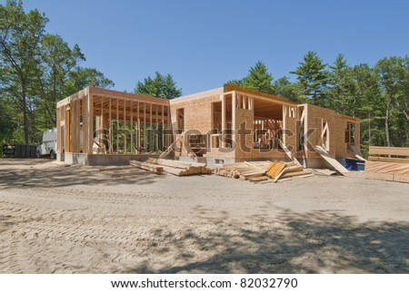 New home under construction with only the lower level built - stock photo