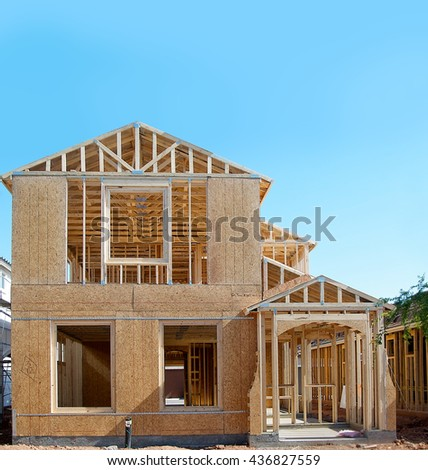 New home under construction - wood frame - stock photo