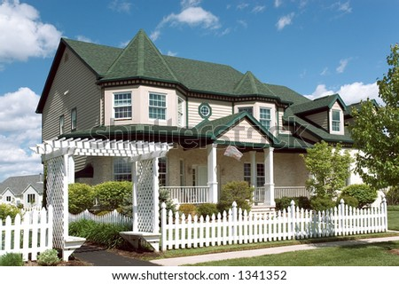 New home with a Victorian flavor architecture. Just one of many new house photos in my gallery. - stock photo