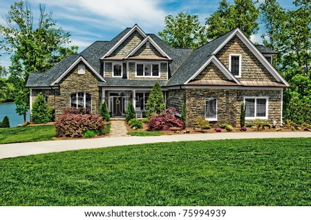 New Home with Beautiful Landscaping - stock photo