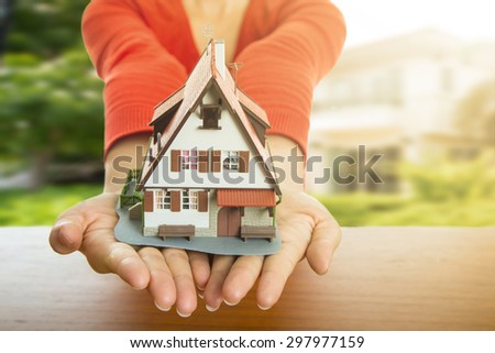 New home ,Woman show model house and real agency property.  - stock photo