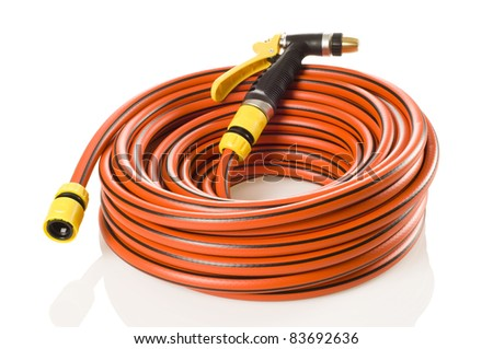 New hose nozzle and 20 meters long, 12.5 mm diameter garden hose. - stock photo