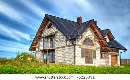New house and blue sky - stock photo