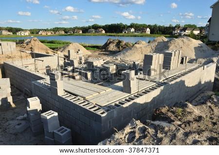 New house construction, building foundation walls using concrete blocks, copy space - stock photo
