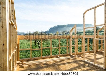 new house construction interior with exposed framing  - stock photo