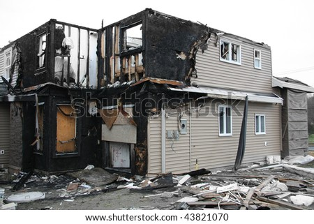 New house destroyed by fire. Also available in vertical. - stock photo