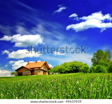 New house imagination on green meadow - stock photo