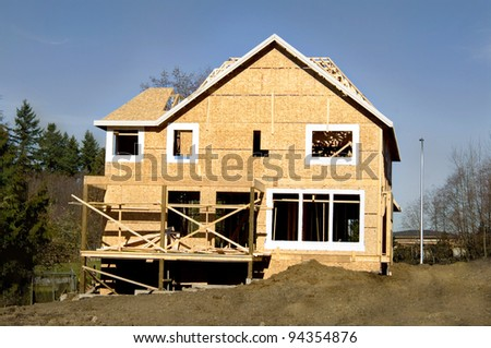 new house in construction . work in progress on urban property.. - stock photo