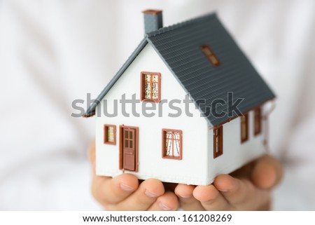 New house in hands - stock photo
