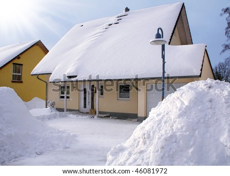 New house in the winter with snowflakes - stock photo