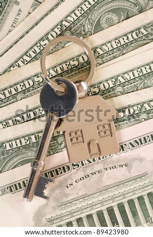 New house keys on american dollars - stock photo