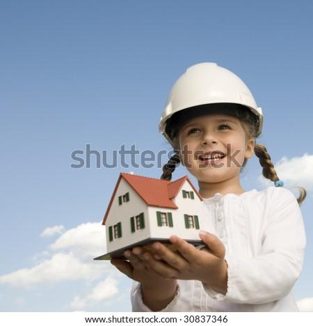New house model on girl hands - stock photo