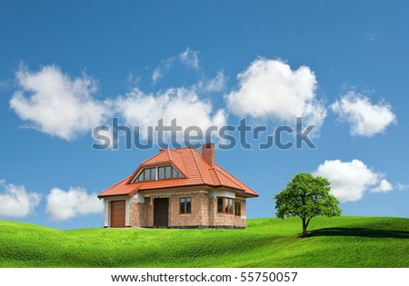 New house on a green hill - stock photo