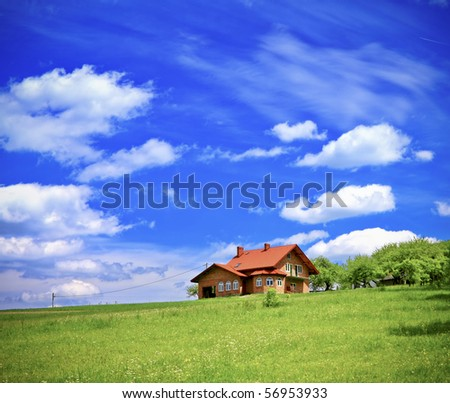 New house on cloudy sky - stock photo