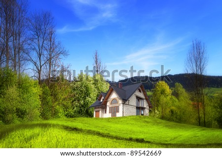 New house on the hill - stock photo