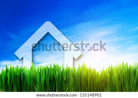 New house perspective on green sunny field. Eco, environment friendly, mortgage investment concepts - stock photo