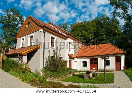 New house with bright blue sky - stock photo