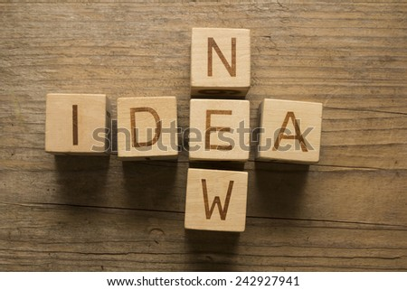 new idea concept on a wooden background - stock photo