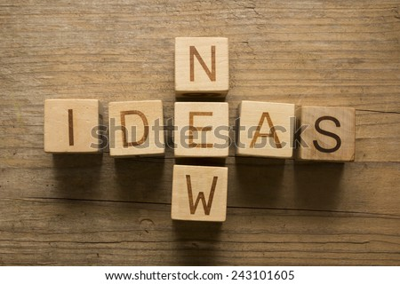 new ideas concept on a wooden background - stock photo