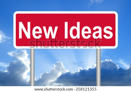New ideas road sign on blue sky with clouds and clipping path - stock photo