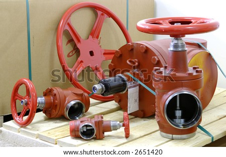 new industrial valves on cardboard packing - stock photo